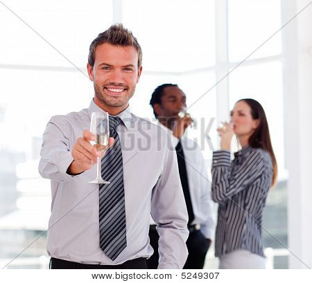 Businessman Drinking Champagne And Celebrating A Success