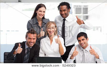 Business Team Working Together With Thumbs Up