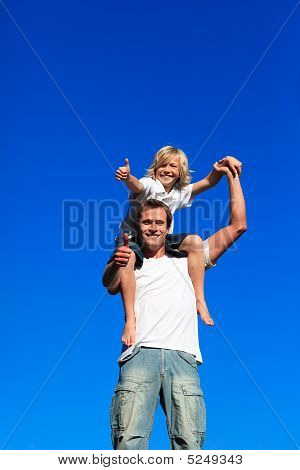 Son On His Father's Shoulders With Thumbs Up