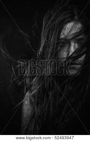 Scary, Portrait of young female beauty with long dark hair in black and white