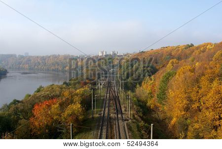 Panorama of the autumn nature and railway in the middle, railway to Kaunas, Lithuania, in autumn