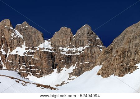 Rocks In Snow And Blue Cloudless Sky