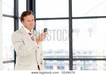 Senior Businessman Sending An Sms With Copy-space