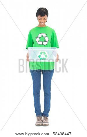 Content black haired ecologist holding a recycling box on white background