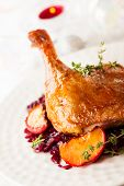 stock photo of roast duck  - Roasted duck leg with red cabbage and apples for Christmas - JPG