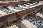 stock photo of bolt  - Rail and bolt of a railway track shown closeup - JPG