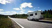 stock photo of motorhome  - caravan on a country road - JPG