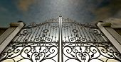image of entryway  - A set of closed ornate gates to heaven under an ethereal light and cloudy afterlife - JPG