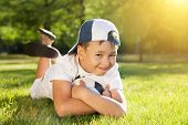 stock photo of ball cap  - Cute little boy with a ball in beautiful park in nature - JPG