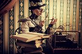 foto of gothic female  - Portrait of a beautiful steampunk woman over vintage background - JPG