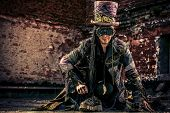 image of post-apocalypse  - Portrait of a steampunk man in the ruins - JPG