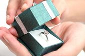 stock photo of marriage proposal  - woman opening ring box - JPG