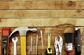 stock photo of sawing  - Assortment of tools on wood - JPG