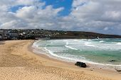 picture of st ives  - Porthmeor beach St Ives Cornwall England with white waves breaking towards the shore and known for surfing - JPG