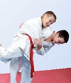 foto of judo  - Two boys with white and red belt perform throw  judo - JPG