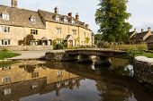 picture of slaughter  - Lower Slaughter with river in Cotswold or Cotswolds district of southern England in the autumn - JPG