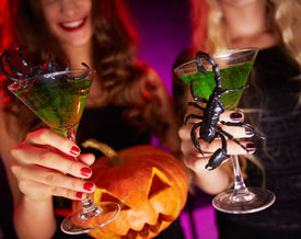 picture of antichrist  - Photo of carved Halloween pumpkin and cocktails with scorpions held by females - JPG