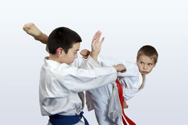picture of karate-do  - Two athletes with red and blue belt doing karate  strikes