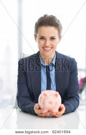 Portrait Of Happy Business Woman Holding Piggy Bank