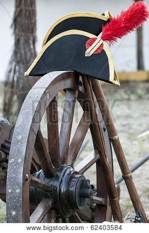 Detail Of Napoleonic Hat On The Wheel Of A Canon During Representation Of The Battle Of Bailen