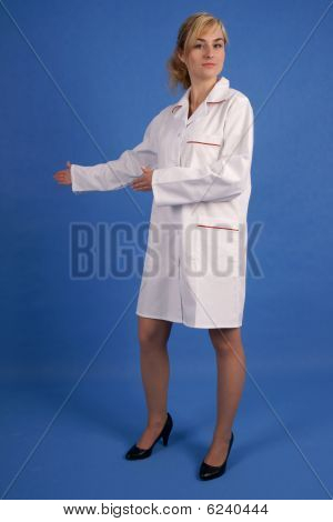 Healthcare worker pointing right with both hands