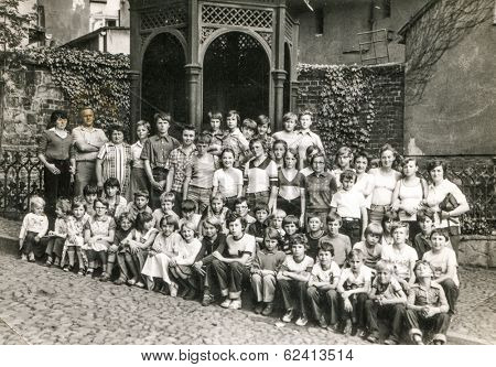 POLAND, CIRCA 1970's: Vintage photo of group of classmates and teachers posing together  during a school excursion