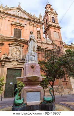 Valencia Santo Tomas church in plaza san Vicente Ferrer with fountain at Spain