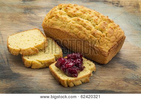 freshly baked, gluten free bread made with almond and coconut flour and flaxseed meal - a loaf and slices with cranberry sauce