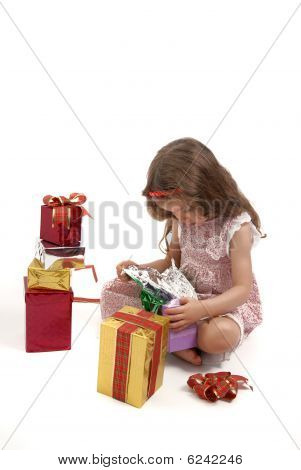 Little Girl Opening Her Christmas Presents