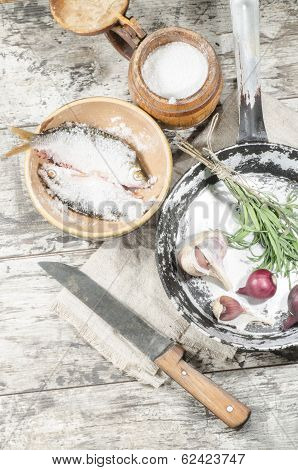 Two Roaches Fish In Ceramic Bowl With Salt.