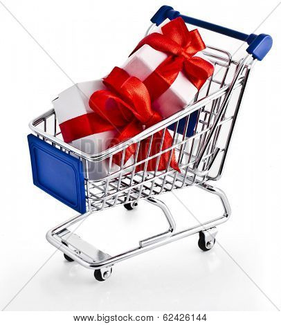 Shopping basket cart with holyday gift boxes - isolated on white background