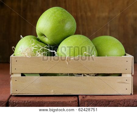 Granny Smith green apples in a wooden box