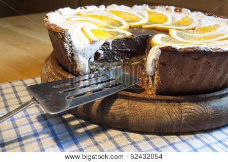 Chocolate Cheesecake On A Wooden Board With Blade For Cake