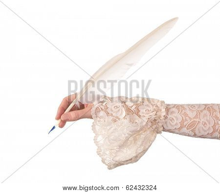 Female hand in antique sleeve writing with a quill feather