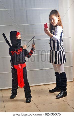 Purim (halloween): Siblings Dressed Up As Soccer Referee And Ninja