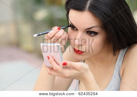 Beautiful Woman Making Up Eyelashes Herself
