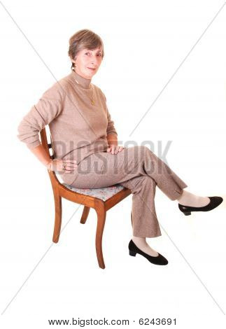 Lady Sitting On Chair.