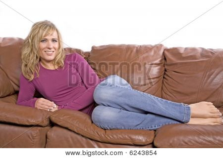 Woman Barefoot On Couch