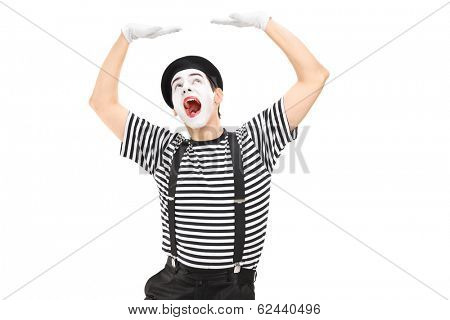 Mime artist simulate carrying something over his head isolated against white background