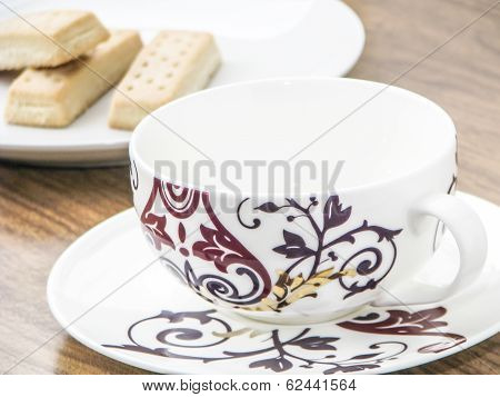 Empty Coffee Cup And Biscuits