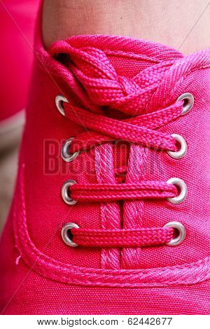 Closeup Of Casual Vibrant Pink Sneakers On Female Feet