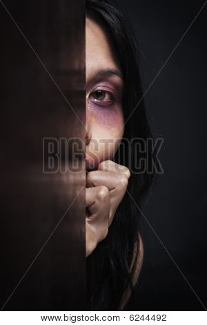 Injured Woman Hiding In Dark