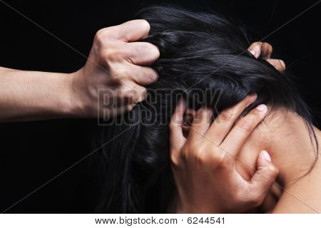Hand Grabbing Woman's Hair