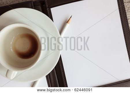 Blank White Notebook, Pencil And Empty Coffee Cup