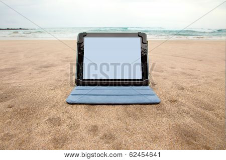 A tablet device on the beach