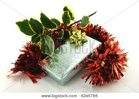 Gift With Holly And Tinsel