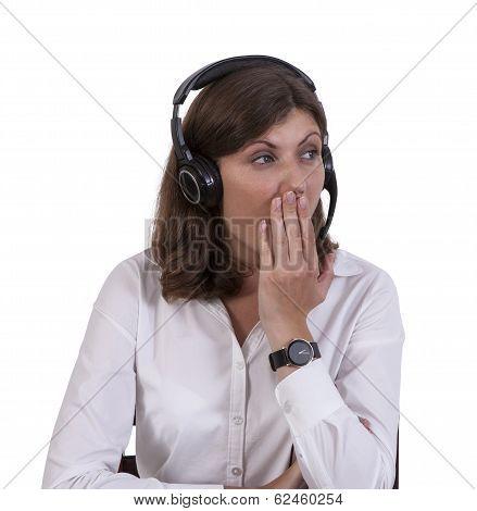 Tired businesswoman yawning