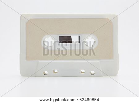 Early 70's cassette tape isolated on natural white background, with slight reflection.