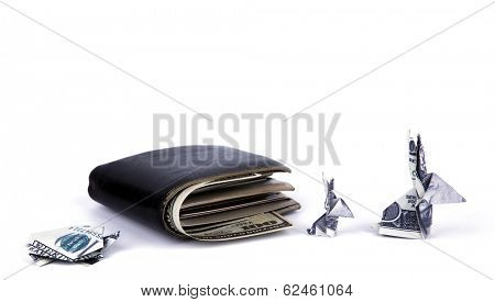 Business concept : Dollar currency origami  rabbit and  turtle with old black wallet on the white background