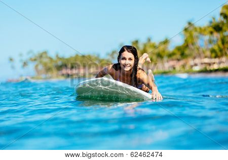 Attractive Young Woman Surfing in Hawaii, Paddling out to the Lineup